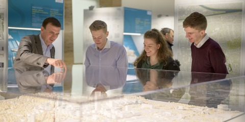 Visitors in front of the model Siemensstadt 2.0